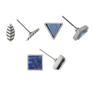 Silver tone, three piece earring set with leaf studs, blue stone studs, and light blue stone studs.