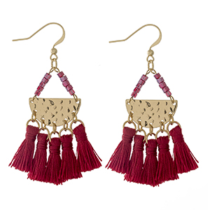 "Gold tone fishhook earrings with red beads and four crimson thread tassels. Approximately 2.5"" in length."