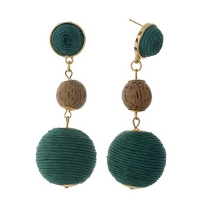 "Gold tone post style earrings with two green thread wrapped beads and a wooden bead. Approximately 2.75"" in length."
