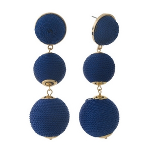 "Gold tone post style earrings with navy blue thread wrapped beads. Approximately 3"" in length."