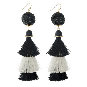 "Gold tone fishhook earrings with a two tone, black and white, tapered tassel. Approximately 4.25"" in length."