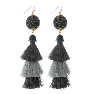 "Gold tone fishhook earrings with a two tone, gray, tapered tassel. Approximately 4.25"" in length."