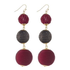 "Gold tone fishhook earrings with burgundy thread wrapped and beaded, beads. Approximately 3.5"" in length."