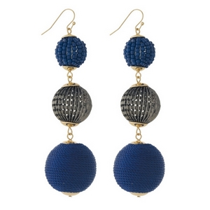 "Gold tone fishhook earrings with navy blue thread wrapped and beaded, beads. Approximately 3.5"" in length."