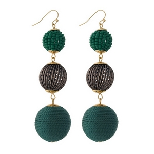 "Gold tone fishhook earrings with green thread wrapped and beaded, beads. Approximately 3.5"" in length."