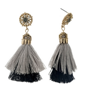 "Gold tone post style earrings with a layered gray and black thread tassel. Approximately 2.5"" in length."