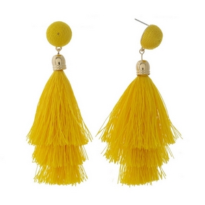 "Gold tone stud earrings with a yellow thread wrapped bead and tapered tassel. Approximately 3.5"" in length."