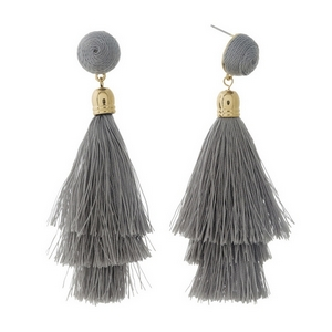"Gold tone stud earrings with a gray thread wrapped bead and tapered tassel. Approximately 3.5"" in length."