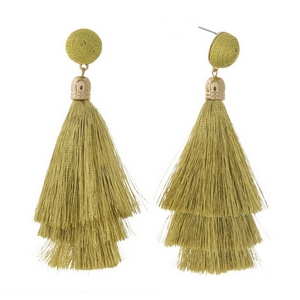 "Gold tone stud earrings with a gold thread wrapped bead and tapered tassel. Approximately 3.5"" in length."