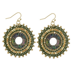 """Gold tone fishhook earrings with a white, green and gold tone beaded circle. Approximately 1.5"""" in diameter."""