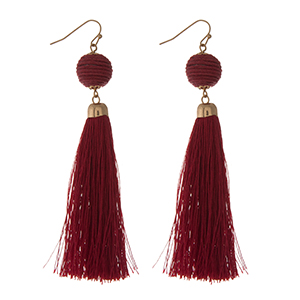 "Gold tone fishhook earrings with a burgundy thread wrapped ball and fabric tassel. Approximately 4"" in length."