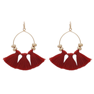 "Gold tone fishhook earrings with three burgundy fabric tassels. Approximately 2"" in length."
