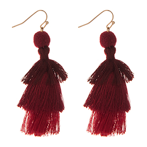 """Gold tone fishhook earrings with a burgundy ombre, tiered tassel. Approximately 2.5"""" in length."""