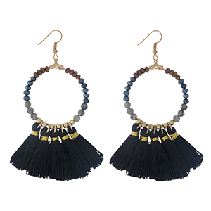 """Gold tone fishhook earrings with a natural stone beaded circle, accented with black thread tassels. Approximately 3"""" in length."""