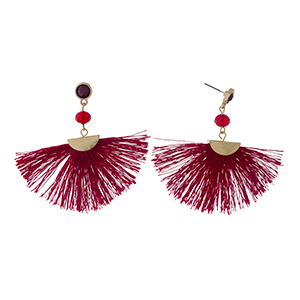 """Gold tone post earrings with a burgundy fan tassel and a faceted bead accent. Approximately 2.25"""" in length."""
