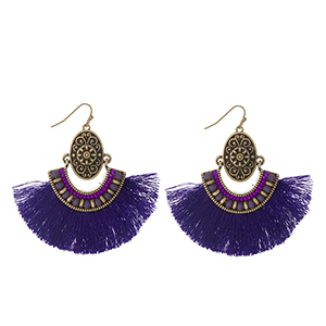"""Burnished gold tone fishhook earrings with a purple fan tassel and faceted bead accents. Approximately 3"""" in length."""