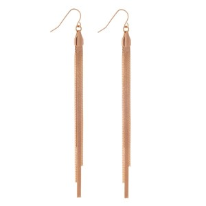 "Rose gold tone fishhook earrings with a snake chain tassel. Approximately 4.5"" in length."