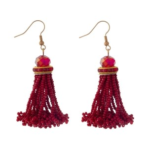 "Gold tone fishhook earrings with a red, seed-bead tassel. Approximately 2"" in length."