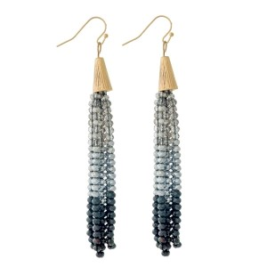 """Gold tone fishhook earrings with an ombre, beaded tassel. Approximately 3.5"""" in length."""