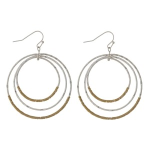 """Two tone, fishhook earrings with cascading circles and wire wrapped accents. Approximately 2"""" in diameter."""