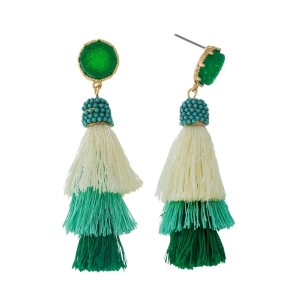 "Gold tone stud earrings with a faux druzy stone and a green ombre, tiered, thread tassel. Approximately 2.5"" in length."