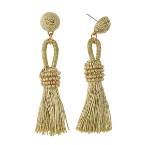 """Stud earrings with a metallic, thread wrapped bead and a metallic thread tassel. Approximately 3"""" in length."""