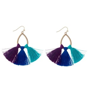 "Gold tone fishhook earrings with an open teardrop shape and purple, blue and mint thread tassels. Approximately 2.5"" in length."