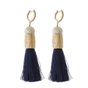 "Gold tone hoop earrings with a pearl bead and thread tassel. Approximately 3"" in length."