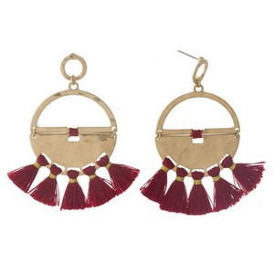 "Gold tone post style earrings with a hammered circle shape and thread tassels. Approximately 3"" in length."