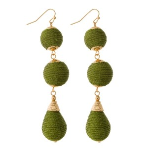"""Fishhook earrings with thread wrapped beads in circle and oval shapes. Approximately 3"""" in length."""