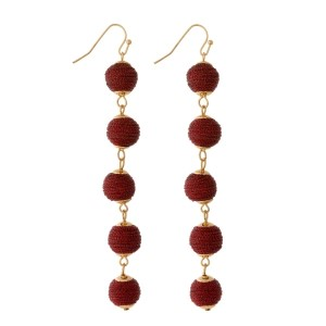 """Gold tone fishhook earrings with five thread wrapped beads. Approximately 4"""" in length."""