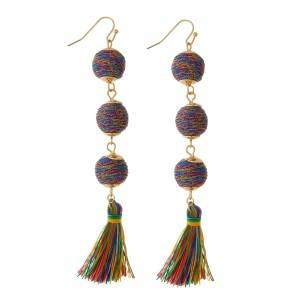 "Gold tone fishhook earrings with three thread wrapped beads and a thread tassel. Approximately 4"" in length."