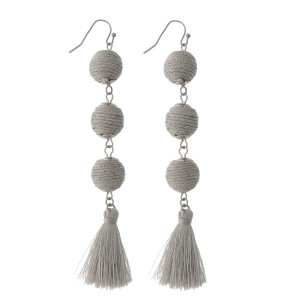 "Silver tone fishhook earrings with three thread wrapped beads and a thread tassel. Approximately 4"" in length."