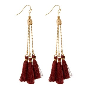 """Gold tone fishhook earrings with thread tassels. Approximately 4"""" in length."""