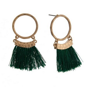 """Gold tone post earrings with an open circle shape and thread tassels. Approximately 2"""" in length."""