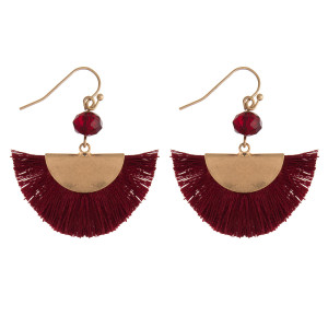 "Gold tone fishhook earrings with a fanned, half circle tassel. Approximately 1.5"" in length."