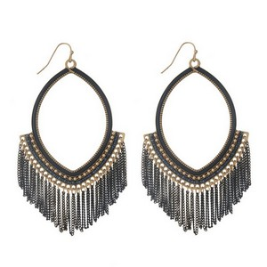 "Burnished gold tone fishhook earrings with an open oval shape and black chain fringe. Approximately 4"" in length."