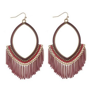"Burnished gold tone fishhook earrings with an open oval shape and red chain fringe. Approximately 4"" in length."