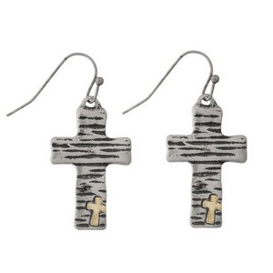"Dainty fishhook earrings with a two tone cross focal. Approximately 1"" in length."