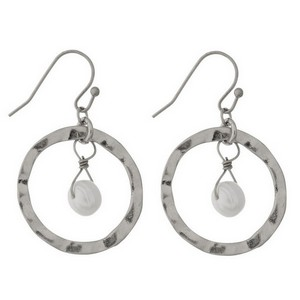 "Dainty fishhook earrings with an open circle shape and a freshwater pearl bead. Approximately 1"" in size."