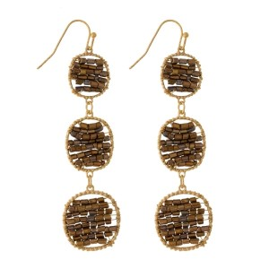 "Gold tone, fishhook earrings with a three part, beaded circle pendant. Approximately 3"" in length."