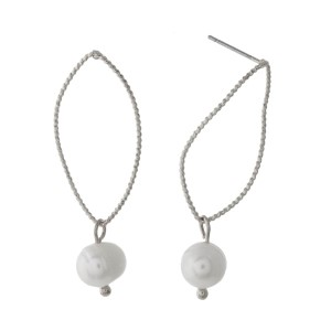 """Dainty stud earrings with an open teardrop shape and a freshwater pearl bead. Approximately 1.25"""" in length."""