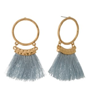 "Gold tone post earrings with an open circle shape and thread tassels. Approximately 2"" in length."