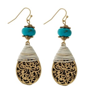 "Metal fishhook earrings with a filigree patterned teardrop shape, a turquoise bead, and two tone wire wrapping details. Approximately 2"" in length."