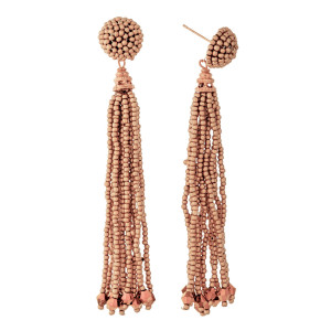 "Gold tone stud earrings with a beaded tassel. Approximately 3.25"" in length."