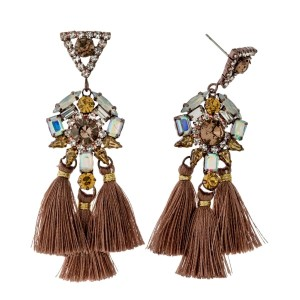 "Rhinestone stud earrings with threaded tassel accents. Approximately 3"" in length."