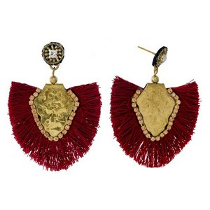 """Burnished gold tone stud earrings with a bohemian shape and fanned tassel. Approximately 2"""" in length."""