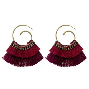 "Burnished gold tone hoop earrings with ombre, fanned tassels and rhinestone accents. Approximately 2.5"" in length."