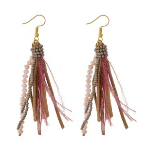 "Gold tone fishhook earrings with beaded, feather, and faux leather tassels. Approximately 3"" in length."