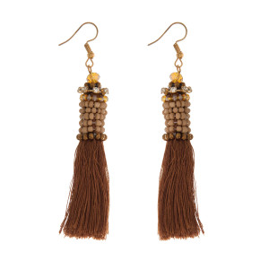 """Gold tone fishhook earrings with a thread tassel and bead-wrapped detail. Approximately 4"""" in length."""